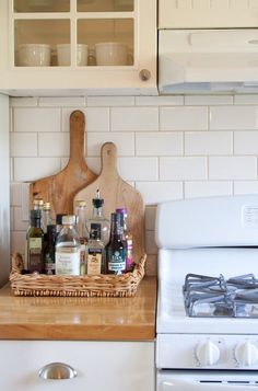 A low basket is a neat and tidy place to corral bottles of oil and other kitchen ingredients.