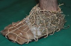 Ancient Craft. Recreation of Otzi's shoes (5,300 year old 'Iceman' found in the Alps in 1991)