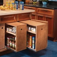 Vertical roll out drawers are a great way to convert a half-empty base cabinet into a high-capacity food storage cabinet.