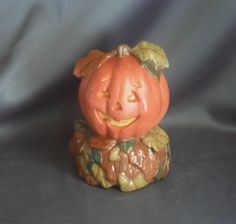 """This adorable Jack -O- Lantern is nestled in a colorful pile of fall leaves and is hand painted with acrylic paint making it a great Halloween decoration. It is 6"""" tall by 4"""" in diameter. Great gift idea for that person that loves Halloween all year ..."""