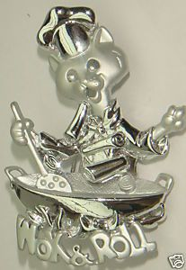 ANOTHER WHIMSICAL DANECRAFT PIECE.....THIS ONE HAS TERRIFIC HIGH POLISHED SILVER AND MUTED SILVER MATT PLATE.....CHINESE COOL CAT COOKING UP SOME YUMMIES IN HER WOK.....THE DETAIL IS TERRIFIC AS WITH ALL SIGNED DANECRAFT PIECES.......THIS ONE MEASURES 2 AND 1/4 INCHES TALL