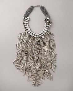 This Beaded Fringe bib necklace by Vera Wang makes a statement with brass cable chains and round-cut crystals. Bergdorfgoodman.com