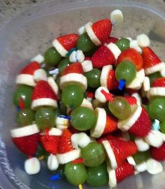 Grinch kabobs: grape, banana, strawberry, marshmallow.