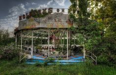 Jungle Ride - Vintage caterpillar ride left behind in an abandoned amusement park
