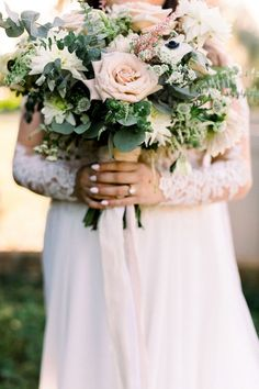 Bride holding wedding bouquet with blush garden roses Click pin to see more Orange Blossom Bride | Orlando Wedding Blog #orlandowedding #dustybluewedding #dustyblue Blush Wedding Colors, Floral Wedding, Wedding Flowers, Wedding Dresses, Wedding Blog, Wedding Day, Lakeside Wedding, Dusty Blue Weddings, Orlando Wedding