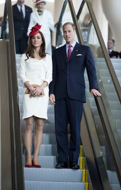 This is the best Kate Middleton outfit she's ever worn. I love the red shoes and fascinator as subtle but striking details to the white dress.