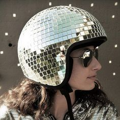 The Disco Ball Helmet Vintage-style 3/4 Open Face Helmet Liner with detail stitching and contrasting ventilated panels in the top Embossed goggle strap Vintage style chrome strip Helmets are non-DOT approved and meant for novelty purposes only