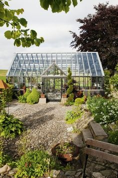Large greenhouse to harbor all the summer annuals thru winter months!