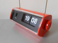 Vintage 1970s COPAL Flip Clock. Orange Plastic. Made in Japan. Working condition. Retro Mod Space Age. Bedroom Home Decor. Electronics by FranzsFavorites on Etsy https://www.etsy.com/listing/289246303/vintage-1970s-copal-flip-clock-orange