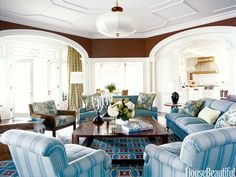 Club chairs are covered in French Stripe in blue/gray by Kathryn M. Ireland; cushions on the Bielecky Brothers cane chair are Jasper's Tree of Life in sage; sofas are in Blanford in Old Blue by Colefax and Fowler through Cowtan & Tout.