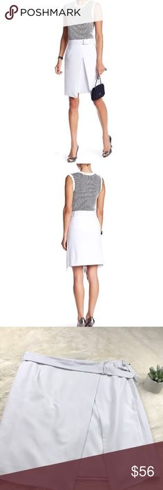 """[amanda + chelsea] faux wrap d ring skirt size 12 ▪️new with tags   ▪️size 12  ▪️color: white   ▪️ faux wrap skirt / d ring belt  ▪️Length 20"""" across  ▪️material: 63% Polyester / 34% Rayon / 3% Spandex   ▪️ Skirt is lined   ▪️we are unable to model this item. no trades. Amanda & Chelsea Skirts A-Line or Full"""