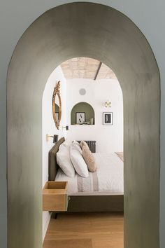 pastel green archway to bedroom inside casa moreno. / sfgirlbybay