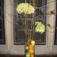 Or this with leaves in the bottom instead of pumpkins and just highlight the calla Lillie's an a few roses among the twigs for your two alter pieces.