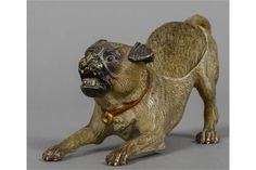 A cold painted bronze pen wipe formed as a pug dog 13 cm wide. CONDITION REPORTS: Some paint wea