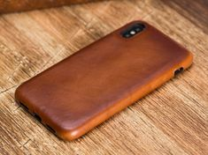 Welcome to the shop.The product is Genuine Leather.The color of the product is brown.Handmade phone case is made of premium quality genuine leather.This wallet case fit for iPhone XExtremely lightweight.Will be more smooth and shiny as time passes by Iphone 6 Pouch, Iphone Cases, Iphone Leather Case, Iphone Models, Leather Cover, Iphone 7 Plus, Metal, Handmade Leather, Smooth