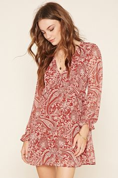 Forever 21 Contemporary - A woven mini dress featuring an allover paisley print, V-neckline, a tie front, long ruffled sleeves, and an elasticized waist.