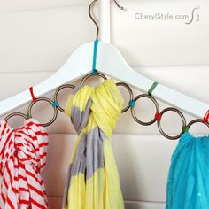 A wooden hanger and metal rings to keep your scarves hanging in style. Whether you've got a ton or just a few, you'll want to make this DIY.