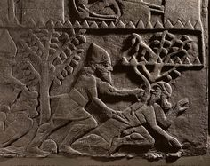 ASSUR RELIEF 10TH-6TH BCE Assyrian warrior kills an enemy. Detail from Ashurnazirpals assault on a city. Stone bas-relief (9th BCE) from the palace of Ashurnazirpal II in Nimrud, Mesopotamia (Iraq). British Museum, London, Great Britain