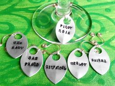handstamped silver wine glass charms set of 6 red wines. made in ireland. by terramor on Etsy Red Wines, Wine Glass Charms, Pinot Noir, Hand Stamped, Ireland, Charmed, Unique Jewelry, Handmade Gifts, Silver
