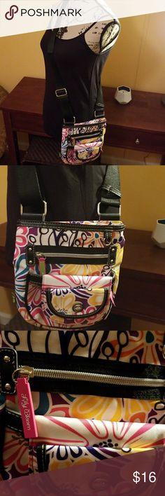 Lily Bloom Crossbody Bag Vibrant floral pattern. Adjustable black straps. I'll Include front wallet which can be unattached for attached. Pinkerior with side zipper. All zippers are functional. Back has an open pocket. Super cute. Logo on zippers. Great condition, maybe used once. Feel free to ask any questions before purchasing.  Thank you for visiting my closet 💓 Lily Bloom Bags Crossbody Bags