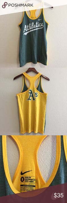 Nike Oakland A's Baseball MLB Racerback Tank Nike Oakland A's Baseball MLB Racerback Tank. This cute Oakland Athletics tank is perfect for baseball season! Loose Fit style. Measurements in pictures. Nike logo and Oakland A's on front and back of tank, perfect yellow and green colors! 💛💚 ⚾️ Nike MLB Tops Tank Tops