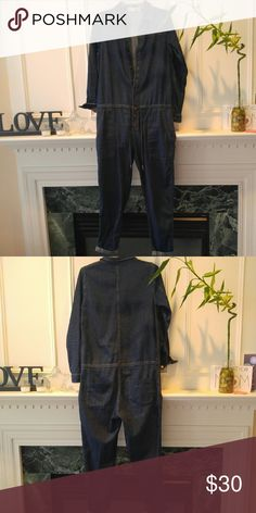 Topshop denim jumsuit Like new denim jumpsuit. Super cute in great condition - only worn once Topshop Jeans