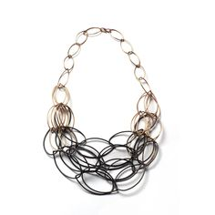 """MEGAN AUMAN - USA  Maya necklace - ombre, two-tone necklace Wire jewelry  """"The jewelry empowers you to make a statement but is easy enough to wear every day. Auman usually works with line, repeated and created from steel and silver."""""""
