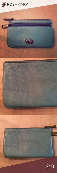 Fossil Wallet Light Teal Fossil wallet.  I got caught in the rain & there are several watermarks (please see photos) through out.  1 photo I.D slot, 9 credit card slots, 3 long slots, and 2 zipper pouches. Fossil Bags Wallets