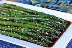 Asian Asparagus or Green Beans....really good but a little salty- reduce soy to 1/4 C and added in 1/4 C teriyaki sauce, needs more kick. Use red pepper flakes and sriracha