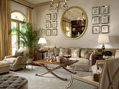 A large mirror like this one here on the stair/foyer wall surrounded by gold & silver frames...loving the idea!
