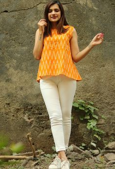 Not your average tank top. This petite top features a swinging silhouette with a playful mix of ikat patterns and button-down back. Short Kurti Designs, Kurta Designs Women, Blouse Designs, Frock Fashion, Fashion Outfits, Casual Outfits, Fashion Tips, Fashion Trends, Stylish Dresses For Girls