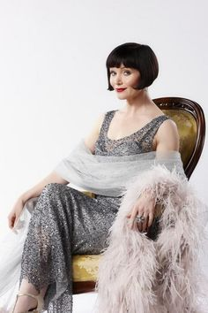 Essie Davis as Phryne Fisher in Miss Fisher's Murder Mysteries.  Loved the first season.  The costumes are lovely, the heroine is smart, sassy and independent the way a heroine should be and the romances are multifaceted.