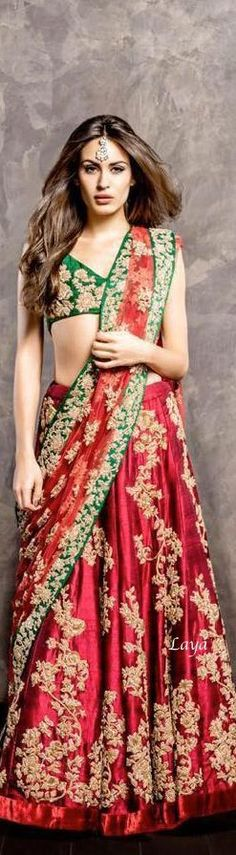 Bridal Lehenga in Red and green. Green choli with zari floral patterns and Lehenga /dupatta with floral embriodery all over. This can be made in different color combinations.Fabric can be silk or geor