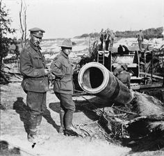 Two Australian soldiers inspect the 380 mm gun of Chuignolles, captured by the 3rd Australian Battalion, 23 August 1918, the largest gun captured in the war