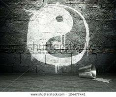 Graffiti wall with yin yang, street art background - stock photo