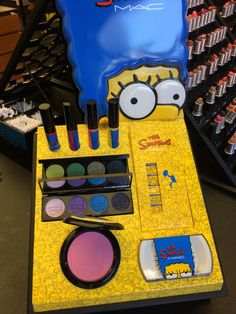 The collection, which has Marge's face all over it, includes hat includes nail stickers ($16.50), eye shadows ($44), lipglasses ($16.50), and lashes ($18.50).