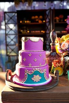 Close up of cake in indian theme dessert bar from sweet and saucy. I can picture this in reds and oranges.