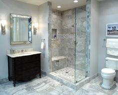 An elegant bathroom featuring Claros Silver travertine.  #thetileshop
