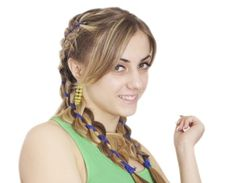 Cornrow Braids - Braiding your hair along with colorful ribbons will give you a cool look.