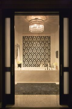 COULD WE WIDEN THE DOOR WAY AND USE THE SPLIT DOORS FOR DRAMA!!! tile design behind tub. Penthouse. Presidential Suite Master Bath
