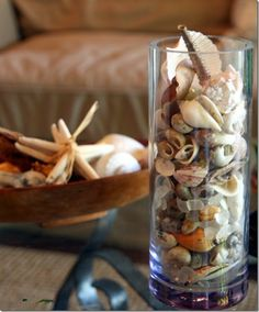 Old wood bowls and tall glass vases - perfect for your shell collection