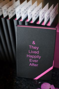 Book wedding favors with in black and hot pink