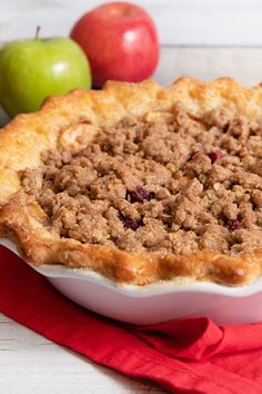 This cranberry apple streusel pie is an easy apple pie recipe! Bake the best apple pie using Granny Smith apples, cranberries, cinnamon, and rolled oats. You will love baking this apple dessert for a fall dessert or Thanksgiving dessert!