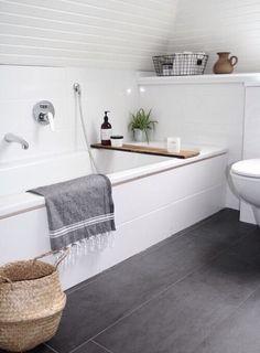 low ceiling bathroom // dark floors // white shiplap ceiling // organic styling