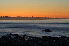 Pre-dawn Sunrise over Long Sands Beach, York Beach, Maine.   To the right, you can see Cape Neddick/Nubble Lighthouse.  5/18/13.