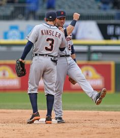 Ian Kinsler Photos - Ian Kinsler and Andrew Romine of the Detroit Tigers celebrate a win over the Chicago White Sox at U. Cellular Field on April 2014 in Chicago, Illinois. The Tigers defeated the White Sox - Detroit Tigers v Chicago White Sox Pittsburgh Pirates Baseball, Detroit Sports, Detroit Tigers Baseball, Tiger Team, Ian Kinsler, Tiger Love, Team Photos, Chicago White Sox, San Francisco Giants