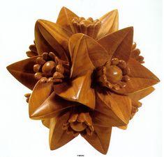 Polyhedron with Flowers - M.C. Escher