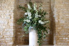 Milk Churn with Green and White garden flowers.  Photograph by Anna Barclay