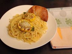 Stuffed yellow courgettes on a bed of garlicky spaghetti