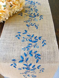 Chic,rustic,elegant,this table runner is a lovely decor for your wedding table or any other occasion!I ~ DETAILS ~ ~ This listing includes one 100% natural Jute / burlap table runner that is overlocked on all sides for durability and beauty and adorned with hand painted blue